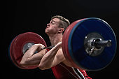 Young man performing deadlift