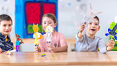 Children with paper puppets