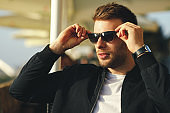 Portrait of a handsome man with sunglasses outdoor