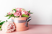 Beautiful and tender bouquet of flowers in the hat box,
