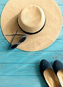 Women's accessories - shoes, hat and sunglasses of blue color.