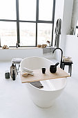 Urban Bathroom With Oval Bathtub Window Background