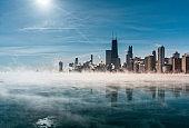 Chicago Downtown skyline during winter polar vortex .Fog drifts across Lake Michigan