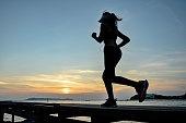 Jogging at sea sunset