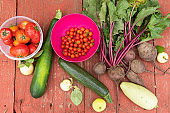 still life fresh fruits and vegetables on a wooden table top view