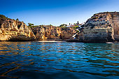 Paradise Beach surrounded by dramatic Algarve cliffs in Portugal