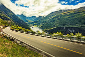 Eagle road and cruise ships on fjord, Geiranger Norway.