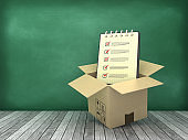Cardboard Box with Check List Note Pad on Wood Floor - Chalkboard Background - 3D Rendering