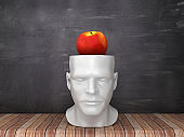 Human Head with Apple on Chalkboard Background - 3D Rendering