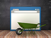 Web Browser with Wheelbarrow on Chalkboard Background  - 3D Rendering