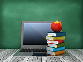 Laptop with Books and Apple on Chalkboard Background - 3D Rendering