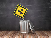 Trash Can with Radioactive Road Sign on Chalkboard Background - 3D Rendering