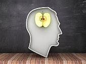 Human Head Shape with Apple on Chalkboard Background - 3D Rendering
