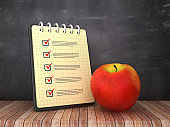 Check List Note Pad with Apple on Chalkboard Background  - 3D Rendering