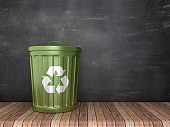 Trash Can with Recycling Symbol on Chalkboard Background - 3D Rendering