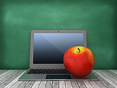 Laptop with Apple on Chalkboard Background - 3D Rendering