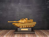 Trophy with Military Tank on Wood Floor - Chalkboard Background - 3D Rendering