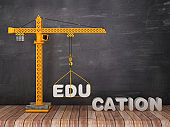 Tower Crane with EDUCATION Word on Chalkboard Background - 3D Rendering