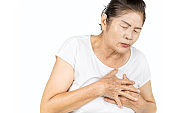 old asian woman having heart attack isolated on white background