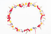Flat lay frame with colorful autumn berries and apples on a white background