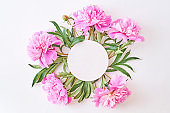 Mockup round white frame with pink peonies on a white background