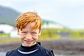 Close-up portrait of happy boy with redhead