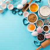 Ingredients and utensils for baking, blue background