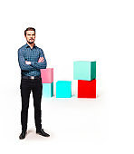 Man standing next to colorful text boxes.