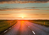 Beautiful view of sunset over an empty road