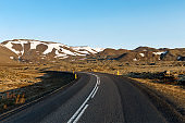 Empty winding road and mountains in Iceland