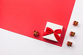 Present white gift box with red bow