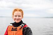 Portrait of smiling girl against Laugarvatn lake