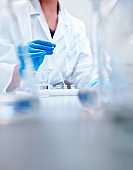Chemist examining solution in test at factory