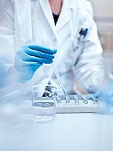 Chemist examining medical solution in laboratory