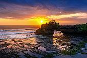 Beautiful sunset at Tanah loh temple in Bali, Indonesia.
