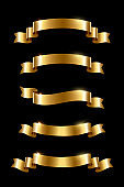 Golden luxury ribbons set. Vector design elements isolated on black background.