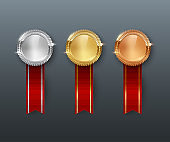 Vector gold, silver, bronze medals and vertical red ribbons isolated on gray background.