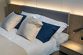 White and black pillows on a bed