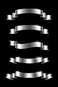 Silver luxury ribbons set. Vector metal design elements isolated on black background.