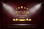 Golden shiny award sign with star and ribbon isolated on dark red background. Vector illustration.