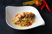"crispy Pork belly spaghetti with background""n"