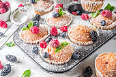 Muffins or cupcakes with berries
