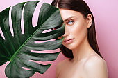 Beauty Woman with natural green palm leaf Portrait