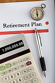 Retirement Plan document with compass, calculator, and pen