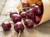 Fresh cherries on a wooden table in the kitchen