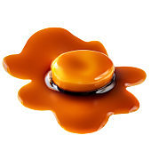Sweet caramel candy and flowing caramel sauce isolated on a white background.