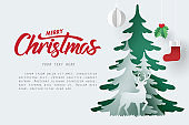 Paper art of deer and pine forest with Merry Christmas calligraphy