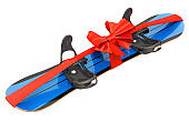 Snowboard with strap-in bindings wrapped ribbon and bow, gift concept. 3D rendering isolated on white background