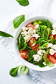 Cherry tomato, corn lettuce and cucumber salad with feta. Copy space. Flat lay