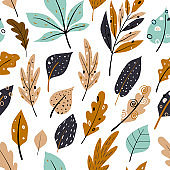 Seamless pattern with autumn oak leaves in Orange, Beige, Brown and Yellow.